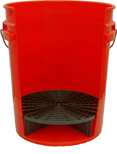 The Grit Guard is a raised grid surface that sits in the bottom of the included 5 gallon bucket.