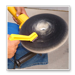 Take a moment to fluff the pad by holding the Duo Spur Pad Cleaning Tool to the wool as the pad spins.